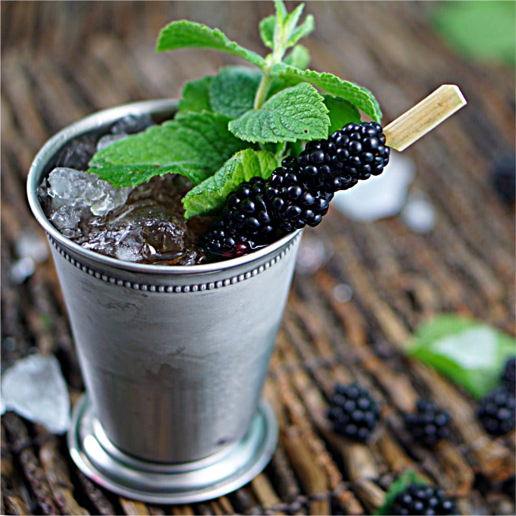 Blackberry Mint Julep is a twist on a classic. Bourbon, simple syrup, mint leaves, club soda and blackberries~By Wet Whistle Drinks by Darla Bentley