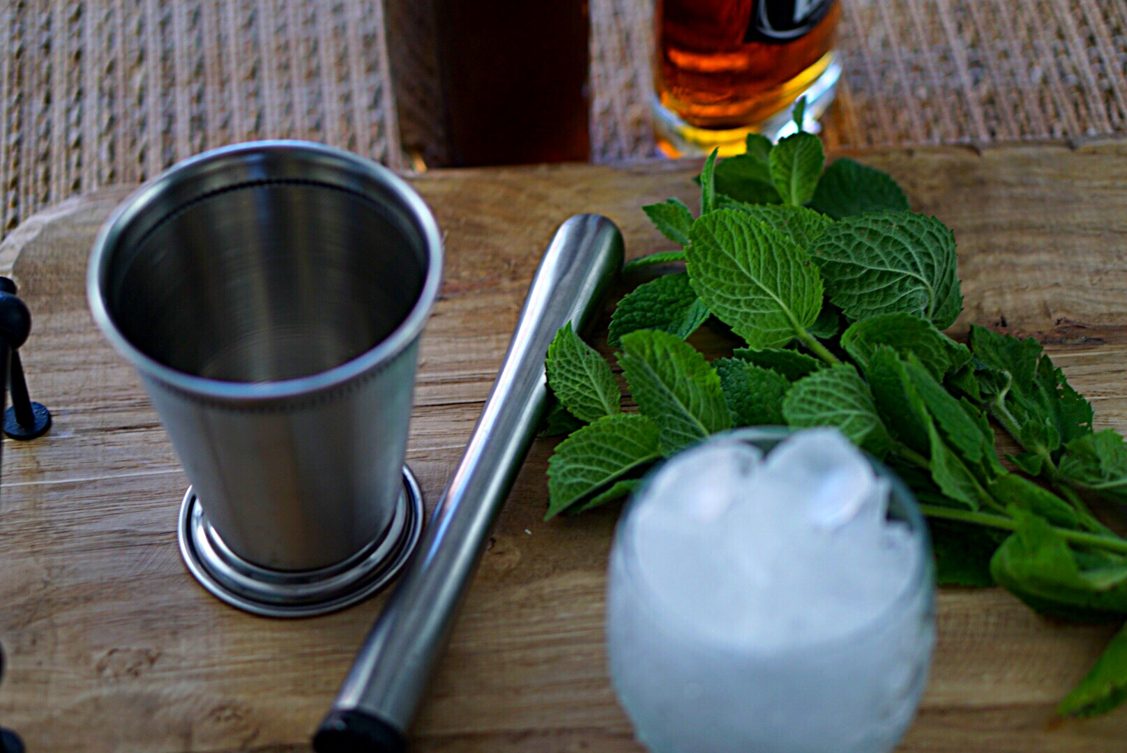 A Mint Julep is made with bourbon, simple syrup, and mint leaves. Enjoy this tradition of the south~By Wet Whistle Drinks by Darla Bentley