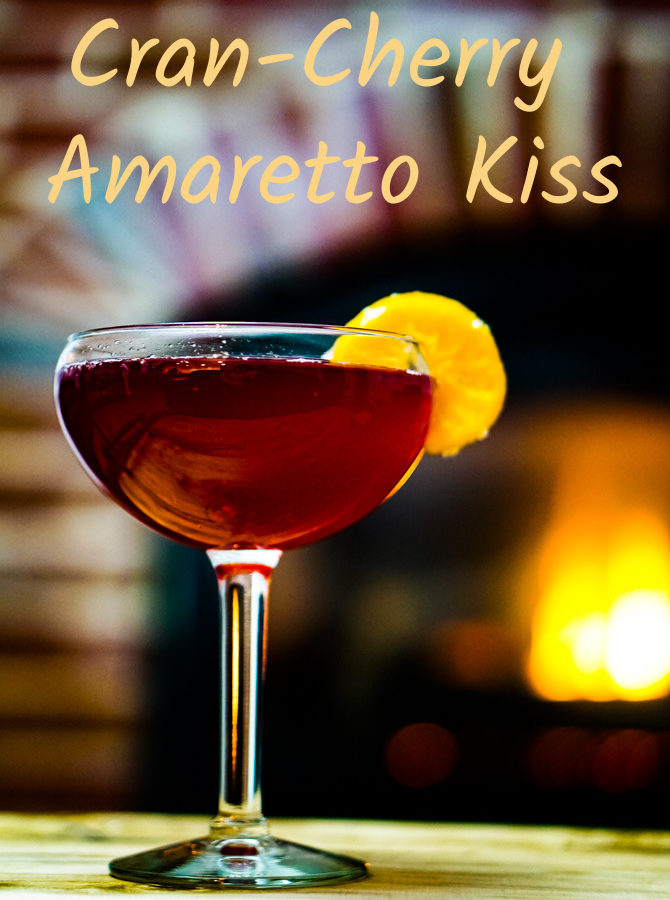 Cran-Cherry Amaretto Kiss has a unique twist of cherry juice to enhance the amaretto. It pulls the flavors together so that this drink dances across your tongue and makes your lips smile. .~By Wet Whistle Drinks by Darla Bentley