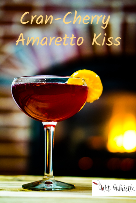 A Cran-Cherry Amaretto Kiss has a unique twist of cherry juice to enhance the amaretto. It pulls the flavors together so that this drink dances across your tongue and makes your lips smile. .~By Wet Whistle Drinks by Darla Bentley