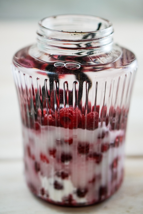 This homemade raspberry vodka liqueur is tasty enough to drink straight! The vanilla beans and frozen raspberries beautifully flavor your favorite vodka. ~By Wet Whistle Drinks by Darla Bentley