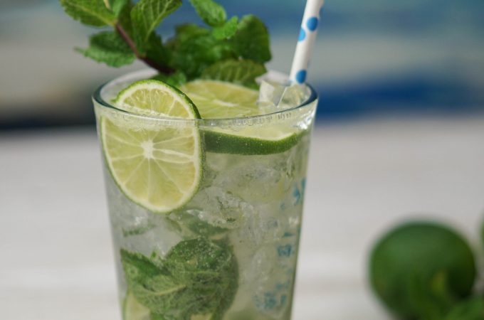 This refreshing cocktail tastes of lime and mint! Add a great rum, sugar and, club soda and, you'll have all that you need for this classic Mojito~By Wet Whistle Drinks by Darla Bentley